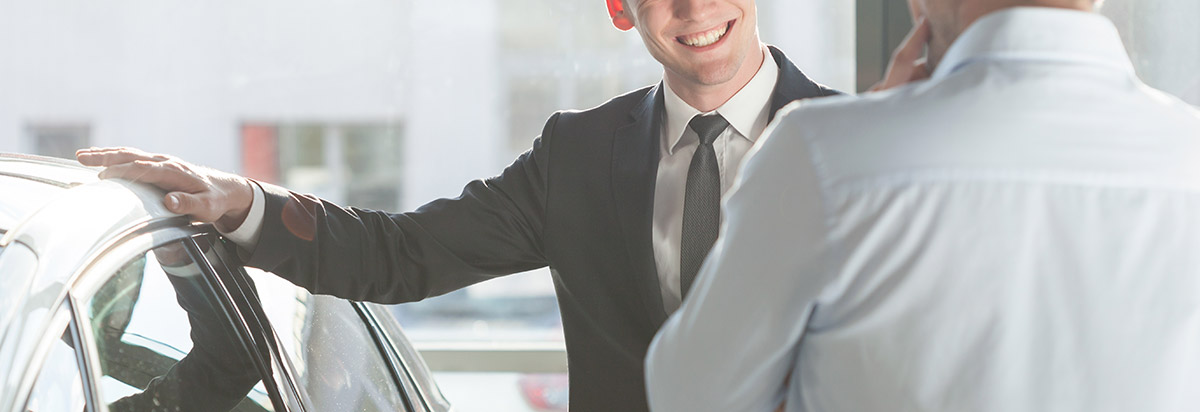 sales person making a deal on a car