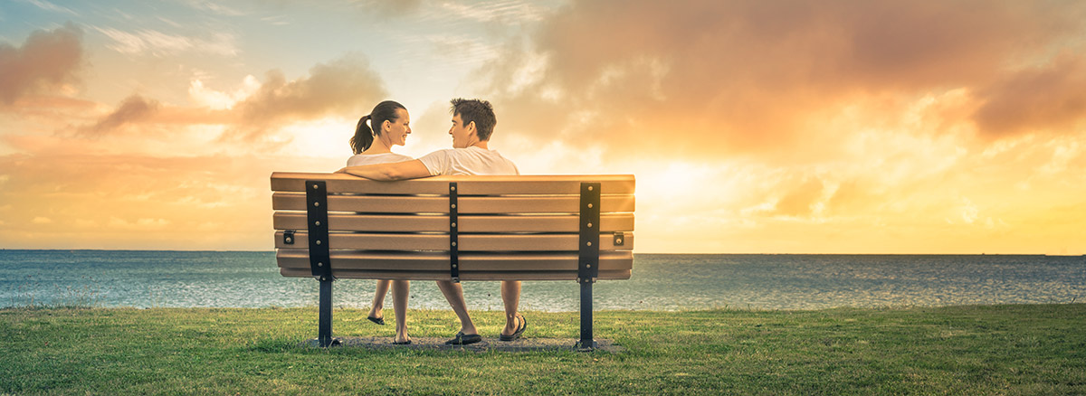 couple sitting at a bench
